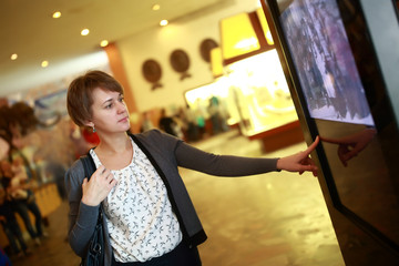 Woman using touch screen