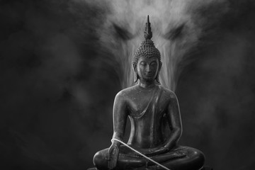 Black and white of The old Buddha Statue and satan smoke or fog