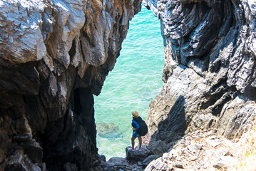Travel people women tourist in a cave near the sea in Keo Sichang, Thailand. Travel Concept