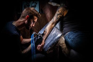 Man creating tattoo