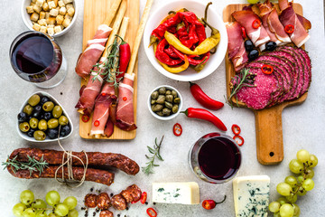 Traditional spanish tapas, wine snack set, food from spain, cheese, meat, vegetables and other appetizers on table, flat lay, overhead