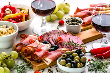 Restaurant with spanish tapas, wine and food from spain, selection of appetizers and traditional dishes on table