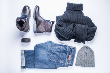 Men's winter clothes on white background. Flat lay and top view