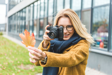 woman taking photo of leaf