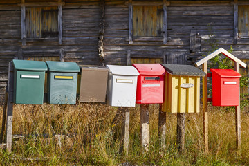 Traditional colorful vintage mailboxes in the countryside