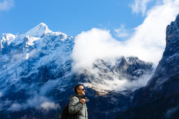 Man in outerwear on a snow-covered mountain