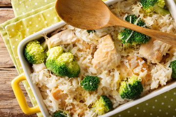 Rice baked with broccoli, chicken and cheese macro. horizontal top view