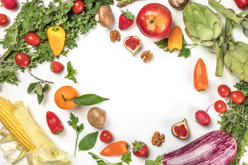 Vibrant fresh vegetables and fruits on white with copyspace