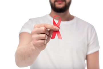 man holding aids ribbon