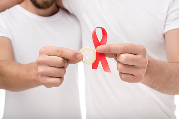 gay couple with aids ribbon and condom