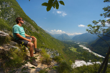 Resting man watching a valley of Soca river, Triglav NAtional Park, Slovenia