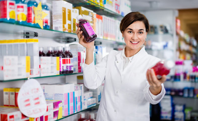 Female pharmacist suggesting useful body care products