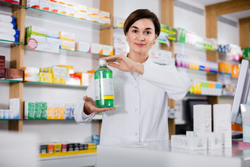 Woman pharmacist showing assortment of care products