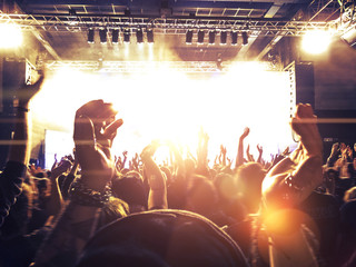 Concert crowd in front of a colorful stage