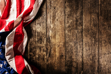 Close-up of USA flag in grunge design, placed on old wooden planks.