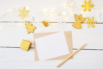 Christmas background with place for your text and golden christmas tree, garland and angel on a white wooden background