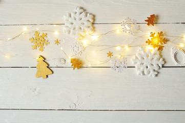 view top of the desktop with the preparations of Christmas. Snowflakes, Christmas trees and garland