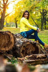 Woman enjoying the autumn in the forest