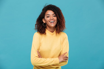 Happy pretty young african woman dressed in warm sweater