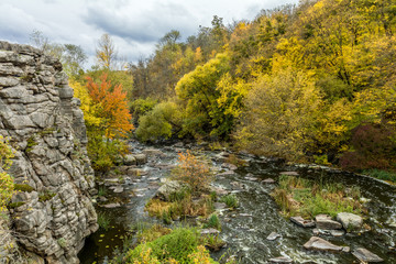 Terrific view of the River Canyon on a cloudy fall day. Buky Canyon on the Hirs'kyi Tikych river in Ukraine. Toned photo.