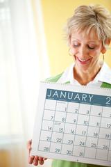 Woman Holding a January 2018 Calendar