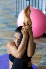 Professional Asian woman play yoga  in gym for good healthy