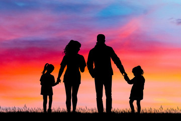 happy family silhouette at sunset