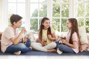 Children Sitting On Window Seat Eating Ice Cream Sundaes
