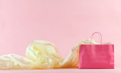 Pink shopping bag and golden fabric