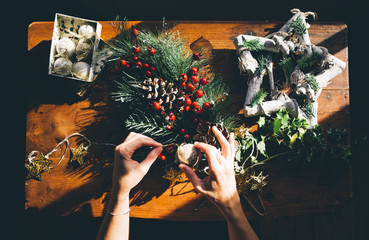 Woman prepares Christmas decorations.