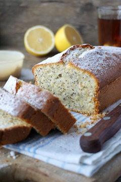 Lemon cake with poppy seeds and powdered sugar