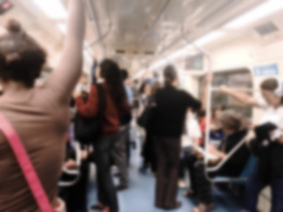 People inside the train wagon at subway station.