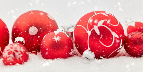 Snow and christmas baubles