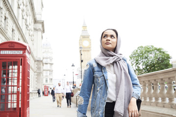 UK, England, London, young woman wearing hijab walking in the city