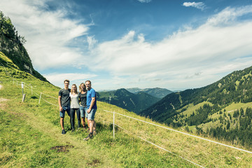 Family enjoying time outdoors near Aggenstein, Pfronten, Bavaria, Germany