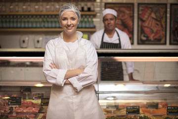 Portrait of smiling woman in butchery
