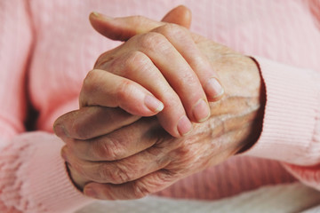 Very old senior woman hands wrinkled skin.