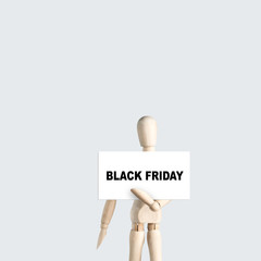 Wooden mannequin hold board with text Black friday for big shopping discount day event