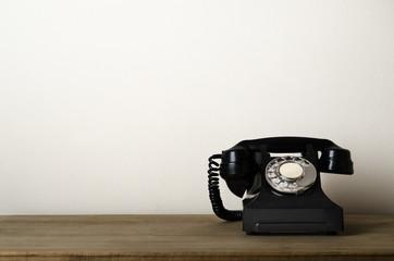 Vintage Black Antique Telephone on Wooden Desk