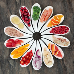 Healthy diet food to promote heart health concept with super foods of fruit, vegetables and fish providing high levels of omega 3 fatty acids, antioxidants, vitamins and minerals.