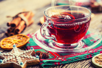 Christmas hot wine or tea drink with orange mandarin star anise cinnamon and gingerbread