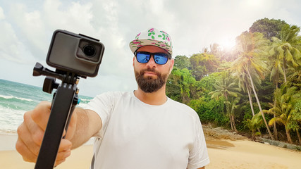 Bearded man with sport camera