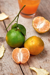 Mandarins. Fresh tangerines on a wooden background