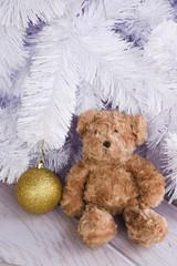 Teddy bear on white Christmas tree