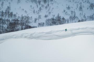 Snowboard jump of a ridge