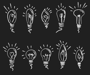 Set of light bulbs. Collection of stylized energy saving light bulbs. Lighting electrical appliance. Drawing on a chalkboard.
