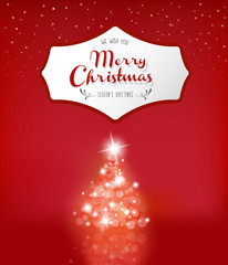 Lighted up Christmas tree with many lensflares on red background and Merry Christmas wishes.