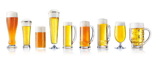 various types of fresh beer in glasses isolated on white