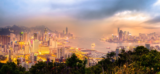 Misty night view of Victoria harbor, Hong Kong