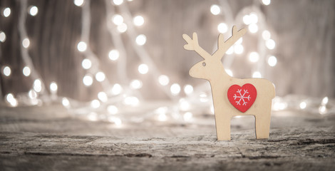 Raindeer ornament and bokeh lightd as christmas or new year background
